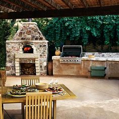 Outdoor kitchen with fireplace, what a cool feature!