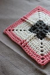 This modern granny square pattern takes inspiration from tapestry crochet techniques to create a pretty but durable piece of work. It would be perfect as a coaster, or as part of multiple squares for a blanket or cushion cover.