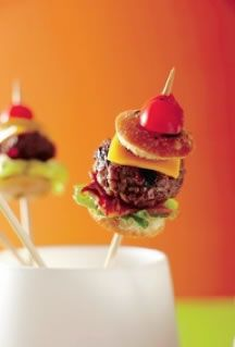 Mini burgers. I like this minus the bun. Small meatball with bacon, lettuce, cheese, tomato and bun on a wooden skewer.