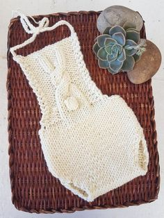 A gorgeous classic baby romper, simple and elegant with an adorable bunny cable on the bib.I made this in 100% merino yarn, but any aran will work It is quite fast to knit up, perfect as a last minute baby shower gift or as a photo prop for a newborn.Light ribbing on the back of the pants to create a nice fit. Simple, classic and elegant.