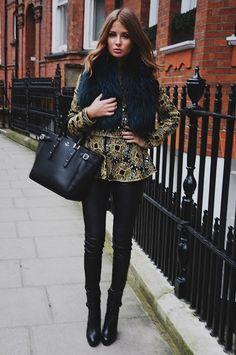 Millie Mackintosh. Black leather pants, snake colored jacket and fur vest. Latest fashion trends.