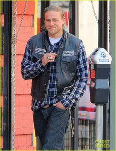 I mean just look at that smile/smirk!! Charlie Hunnam on set 08.06.14