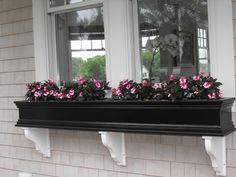 Custom window boxes that are just as beautiful as the flowers!