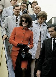 Jackie Kennedy's classic style..a fabulous suit....in a subtle color hue....perfect with her dark hair & gloves....