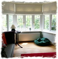 Lined and Interlined Roman Blinds for a bay window.  Made by www.curtainlab.co.uk, fabric by Sanderson, wall paint Farrow.