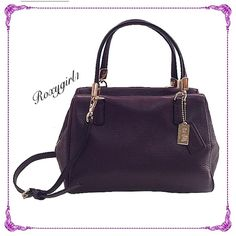 "Coach Madison Leather Satchel Style #49720 Coach Madison Black Violet Leather Satchel Style #49720 Carried Twice! ~ Like New! MSRP: $228 ~ Rare Color Super Soft Pebbled Leather  Top zippered closure with leather pull Light Gold Hardware 4 protective feet on bottom to prevent scuffing 2 Hang tags Interior Satin lining with 1 slip pocket Measures Approx: 9"" L x 6.25"" H x 5"" W Dual leather handles with 5"" drop Detachable & adjustable longer leather strap for shoulder or crossbody wear (approx…"