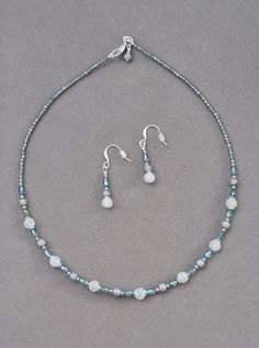 This petite necklace features small glass snowball beads and small oblong crystals in a cool icy blue tone. The necklace is approximately 16 inches long. It includes matching earrings with silver plated earring hooks for wearing comfort (lead, nickel and cadmium free). I can add an