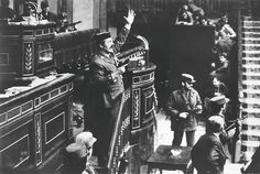 1981. Lt. Col. Antonio Tejero Molina orders everyone to remain seated and be quiet after armed Guardia Civil soldiers stormed the Assembly Hall of the Spanish Parliament. Three hundred deputies and cabinet members were in session to vote upon the succession of premier Suarez. They were released next morning after having been held hostage for almost 18 hours; the coup was a failure. (Manuel Pérez Barriopedro)