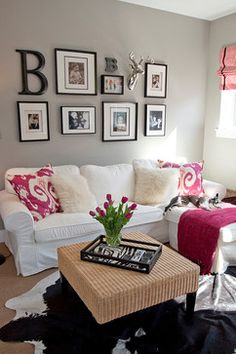 Mill Site House by Judith Balis: Boston Terrier, hot pink, IKAT, cow hide, black and white, fur pillow, photo arrangement, family wall, zebra #homegoodshappy