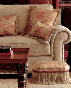 French Country. Love the fringed ottoman!
