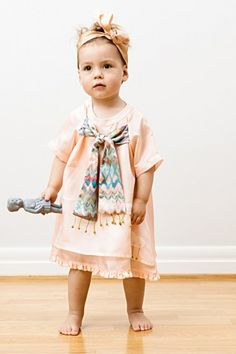 From Grey Likes Weddings: This cutie looks like a stunning little Art Deco flower girl in this LOULOUESKIMO dress