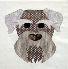 This is a listing for a Silver Schnauzer Appliqued Quilt Block. This block measures 10 1/2 x 10 1/2 and is made of assorted quilt shop quality fabrics. Each peice is hand traced, hand cut and then machine button hole stitched with coordinating color thread. Every thread tail is drawn to the back and threaded through the existing stitching so that it cannot unravel. The background is 100% bleached white muslin. This block would make a great pillow or central motif for a quilt. Made and stored…