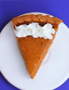 Creamy, smooth, melt-in-your-mouth sweet potato pie… This is my family's favorite recipe - traditional sweet potato pie with a light and flaky pie crust that makes this a staple recipe every year at our Thanksgiving table. You WON'T miss the pumpkin pie at all! http://chocolatecoveredkatie.com @choccoveredkt