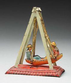 Lot # : 710 - German Tin Litho Swinging Boat Penny Toy.