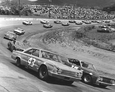 Drivers of the No. 43 in NASCAR history  Thursday, May 18, 2017  Richard Petty (No. 43) rides outside of David Pearson in this 1967 race at Asheville-Weaverville Speedway.  Photo Credit: Getty Images  Photo: 6 / 21