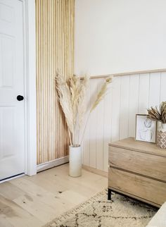Half wall shiplap with a picture ledge aside  this amazing DIY wood slat wall! These special details come together to create a calm, neutral master bedroom.