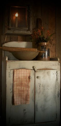 Primitive Cupboard---IDEA for bathroom sink cabinet--bowl or a low crock could be sink ( . . . shown here with old crock, dough bowl, rolling pin & prim wooden candle lantern). An old pump could be added if used as a sink.