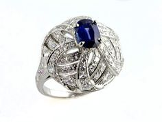 Gem of a Gift Idea # 17:  Platinum Vintage Blue Sapphire and Diamond Ring with a Unique dome--shape and Exquisite detailing.$3600. (Seven Fields Location)