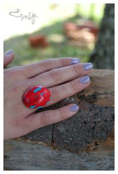Candy apple red and turquoise oval ring from polymer clay. €8.00, via Etsy.