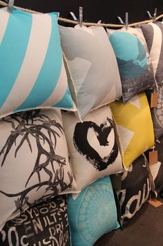 Layers of clothesline to display pillows at a craft fair