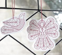Mulberry Paper Ornaments.  Would look nice embroidered on white felt.