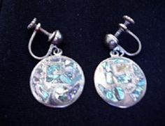 Signed sterling silver earrings with embedded abalone shell pieces.  Versatile earrings reflect turquoise, pink, purple, blue green.  Vintage.  $15 at GoAntiques.  #Vintage #earrings #screw-type