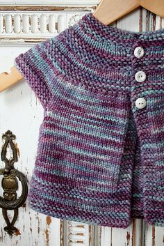 TwoKnitWit's baby lotus, in threes: a baby cardigan by Kelly Herdrich. malabrigo Rios machine washable wool, Lotus color.