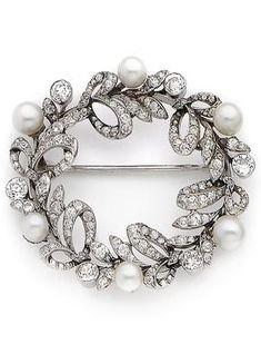 A Belle Epoque natural pearl and diamond wreath brooch, circa Set throughout with old brilliant and rose-cut diamonds, accented at intervals with pearls, old brilliant-cut diamonds approx. Edwardian Jewelry, Antique Jewelry, Vintage Jewelry, Pearl Jewelry, Fine Jewelry, Art Nouveau, Antique Brooches, Pearl Brooch, Royal Jewels