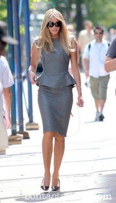 Elle McPherson. Gray peplum dress.
