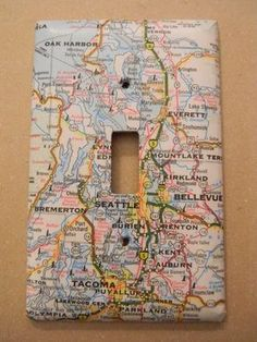 DIY map and globe projects. Celebrate the beuty of our earth and decorate with maps and globes. Here are inspiring DIY projects to try. Switch Plate Covers, Light Switch Plates, Light Switch Art, Decorative Light Switch Covers, Light Covers, Map Crafts, Travel Crafts, Crafts With Maps, Do It Yourself Inspiration