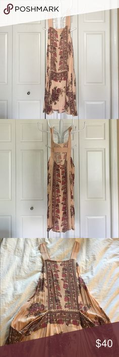 Free People Tunic Gorgeous tunic for a Summer night or layering in the colder months. New without tags Free People Tops Tunics