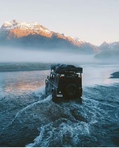 off-roading | road trip | jeep in the water | mountain view | sunrise | adventure | explore | rivers | foggy chill