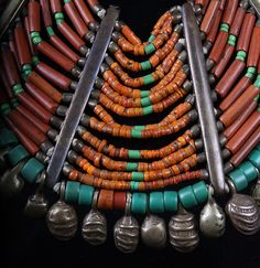 India | Details of superb 19th c. Naga beaded necklace. Origin:  Konyak Tribe  Materials:   beads: (assorted old glass beads, crystal, lapis, turquoise), brass, fiber and shell.  It features ancient and rare beads of which are 200-300 years old.  This necklace would have been an important heirloom piece of great prestige and value which was worn and handed down to consecutive generations.