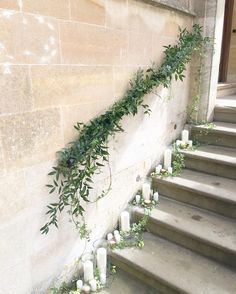 Foliage staircase garland and pillar candles - wedding decorations