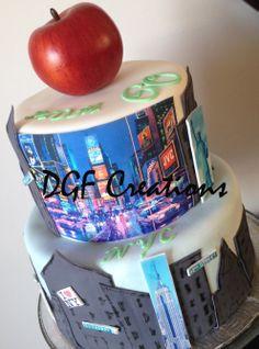 2 Tier New York City Theme birthday cake decorated with buildings and landmark.