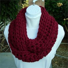 Dark Solid Red Crochet INFINITY LOOP COWL SCARF, 62 x 5   Soft, Warm, and Thick Infinity Scarf hand-crocheted with a high quality acrylic/wool blend yarn. Even though the yarn is categorized as Super Bulky, its very lightweight.    Since this yarn has such a thick strand, it makes fun  beautiful jumbo-size stitches.   The color is called Cranberry - a solid dark red. Wool-Ease yarn is matte (no sheen).   Yarn Content: 80% Acrylic/20% Lambs Wool  Yarn Brand: Lion Brand Wool-ease Thick  Quick…