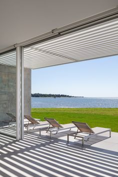 Roger Ferris + Partners embeds pool house in grassy berm in Connecticut