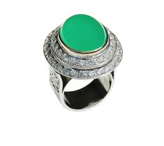 Ring in polished silver and rim around the stone in polished gold. Stone Setting of white zirconias around the ring and stone setting of Quatrz Hydrothermal in Green Calzedonia at the center.