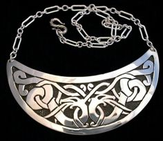 """Firedrake Gorget Mirrored Design in Urnes Style  Based on Stone Carving from Ardre, Gotland 11th Century Sterling Silver Overlay with Chain  Approx. 4.5"""" wide   $645"""