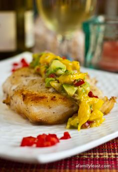 Pan Seared Halibut with a delicious Mango-Avocado Salsa.  The sweet salsa is just perfect with this fresh, tender fish!