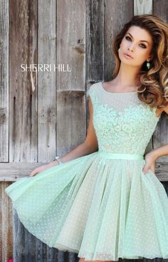 Short and sweet, this lovely polka dot and lace dress is ready for the party! Sherri Hill 11267 features an illusion neckline with lace applique detailing and a lovely ribbon belt. This fun dress is perfect for homecoming, prom or a fabulous birthday party!