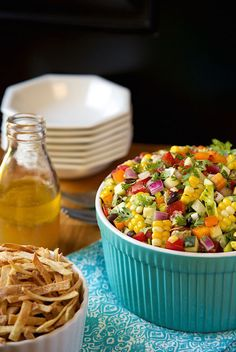 Image of Mexican Chopped Salad with serving bowls and dressing.