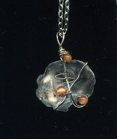 Handmade wire wrapped abalone pendant accented with light orange glass beads on chain. by CraftyClosetCreation on Etsy