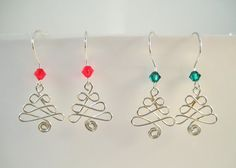 These cute earrings are handmade from argentium silver wire in the shape of a Christmas tree. A 4mm Swarovski bicone bead has been added to the