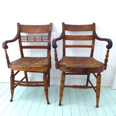 two vintage wooden chairs