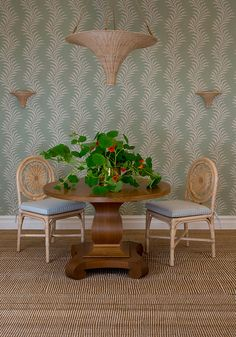 Soane Britain Rattan Carousel Chairs shown with The Nasturtium Hanging Light and Wall Lights – and nasturtium flowers to match!