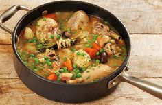 Jacques Pepin Chicken Jardiniere ~ Recipe 2  1/2 ozs lean pancetta 1  1/2 T peanut oil 4 chicken legs (about 2  3/4 pounds) 1  1/2 T AP flour 1 t salt 1 t black pepper 3/4 c fruity dry white wine 3/4 c water 12 small red potatoes8 small baby bella or cremini mushrooms (about 5 ounces), washed 12 small pearl onions (about 4 ounces) 1  1/4 cups diced (1-inch) carrots 1  1/2 tablespoons coarsely chopped garlic 1 fresh thyme branch 1 cup frozen baby peas 2 tablespoons chopped fresh parsley