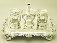 A fine and impressive, large antique Victorian English sterling silver and cut glass desk standish in the Regency style; an addition to our ornamental office silverware. SKU: W8910 Price GBP £2,750.00 http://www.acsilver.co.uk/shop/pc/Sterling-Silver-and-Cut-Glass-Desk-Standish-Regency-Style-Antique-Victorian-57p6102.htm#.U4SVnCjLJM8