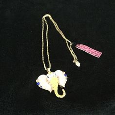 Betsey Johnson Elephant Necklace NWT Yellow elephant Head necklace with  jewels on his trunk and ears. 16 inches long with chain. Betsey Johnson Elephant Necklace Jewelry Necklaces
