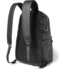 Showcasing the house's meticulous approach to craftsmanship, <a href='http://www.mrporter.com/mens/Designers/Lanvin'>Lanvin</a>'s backpack is made from black leather that's creased for a paper-like effect. It's thoughtfully designed with a lightly padded back and adjustable shoulder straps for total comfort at its heaviest. Store your smartphone, wallet and keys in the handy front zipped pocket.